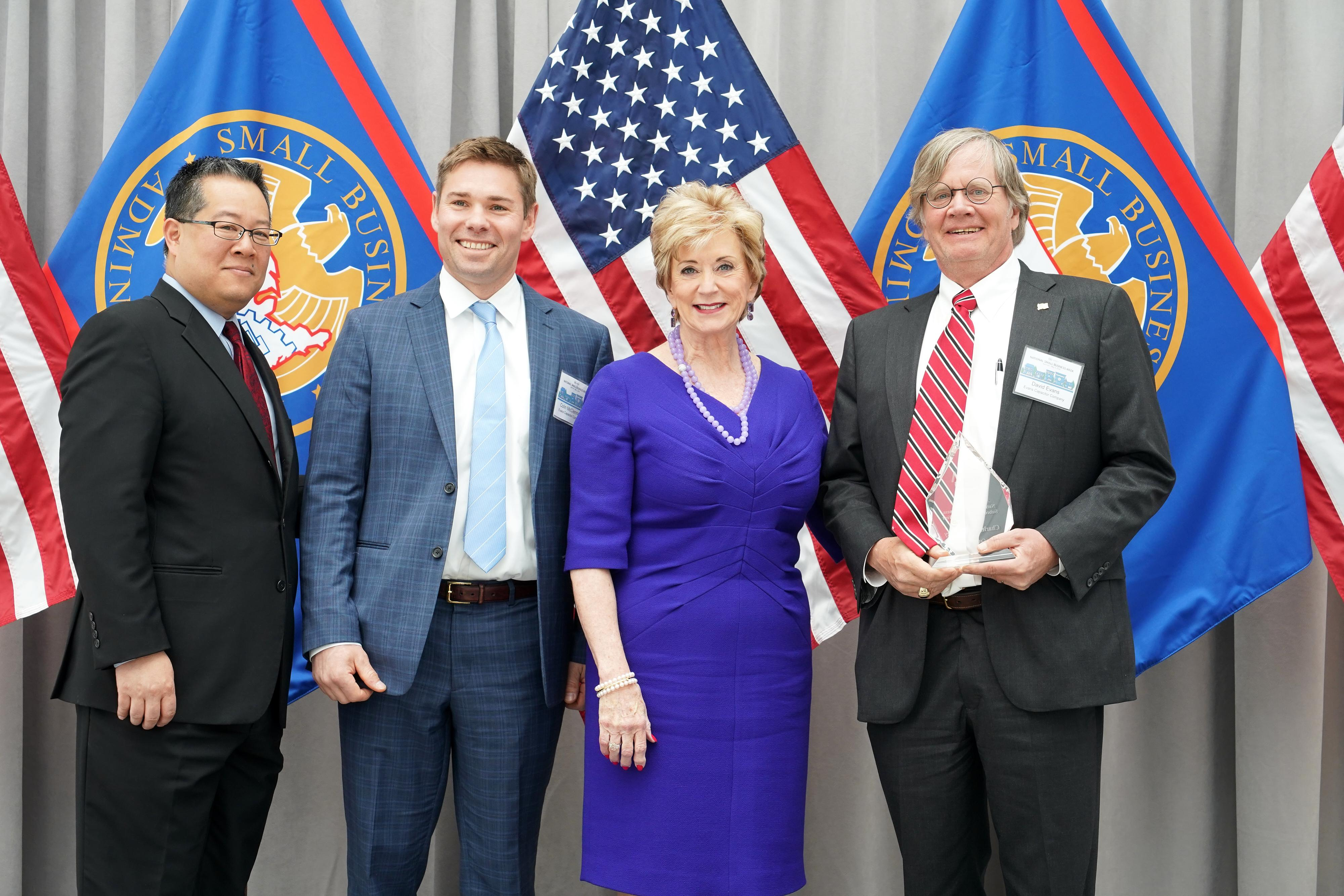 Colin McClennan and Dave Evans Accepting the 2018 Subcontractor of the Year award in Washington DC from Linda McMahon, the Administrator of the Small Business Administration.