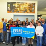 Evans Capacitor Company employees with Evans Banner